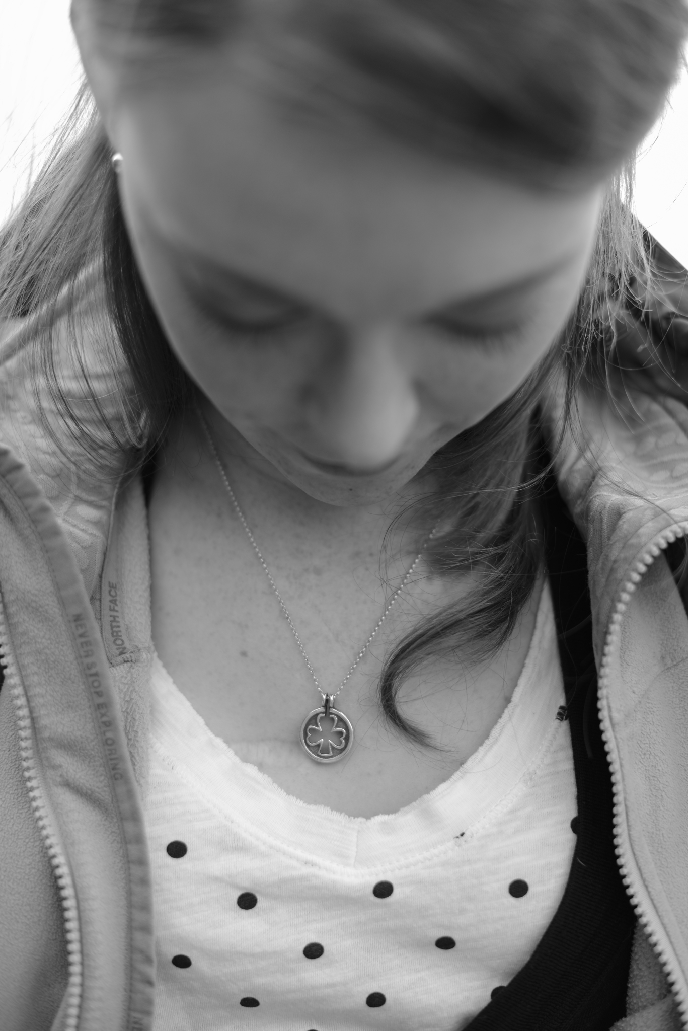 Black and white shamrock necklace  USS Truman naval military homecoming   Maria Grace Photography