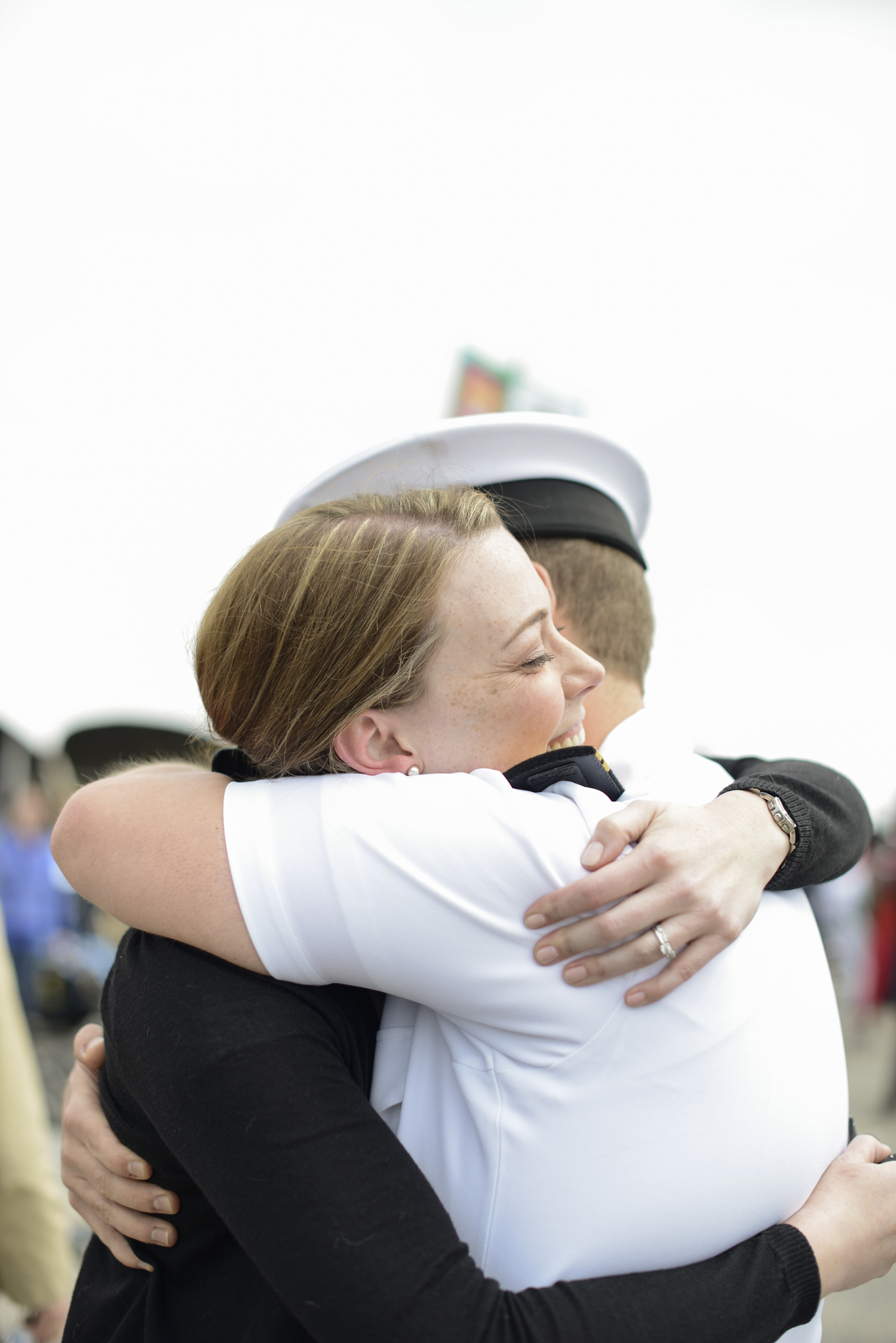 A husband and wife are reunited after a 9 month deployment  USS Truman naval military homecoming   Maria Grace Photography