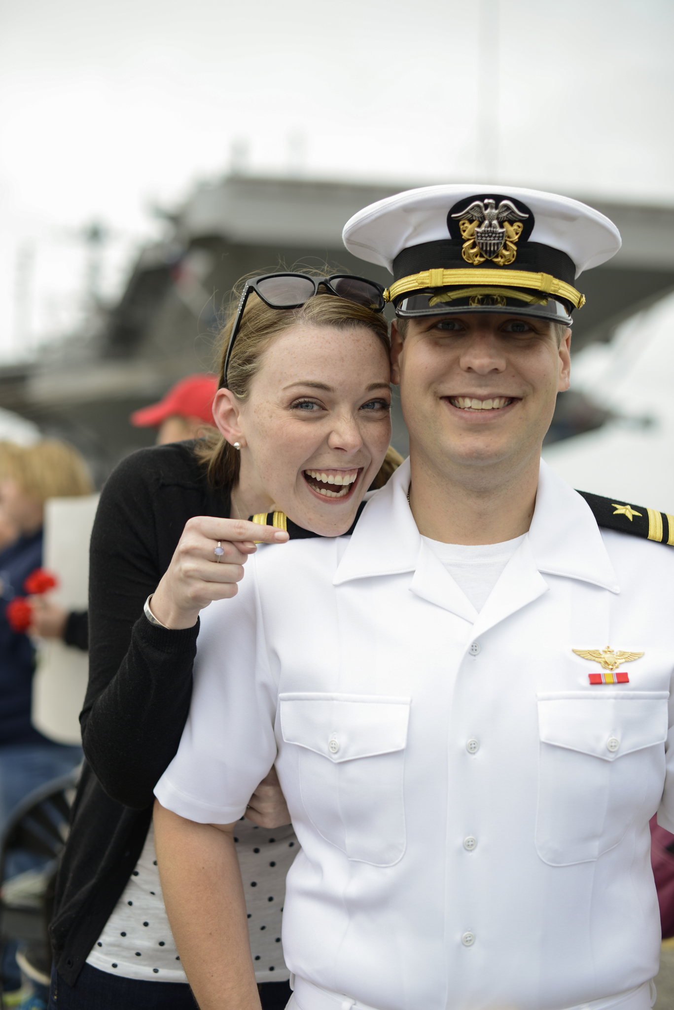 A husband and wife reunite after a 9 month deployment  USS Truman naval military homecoming   Maria Grace Photography