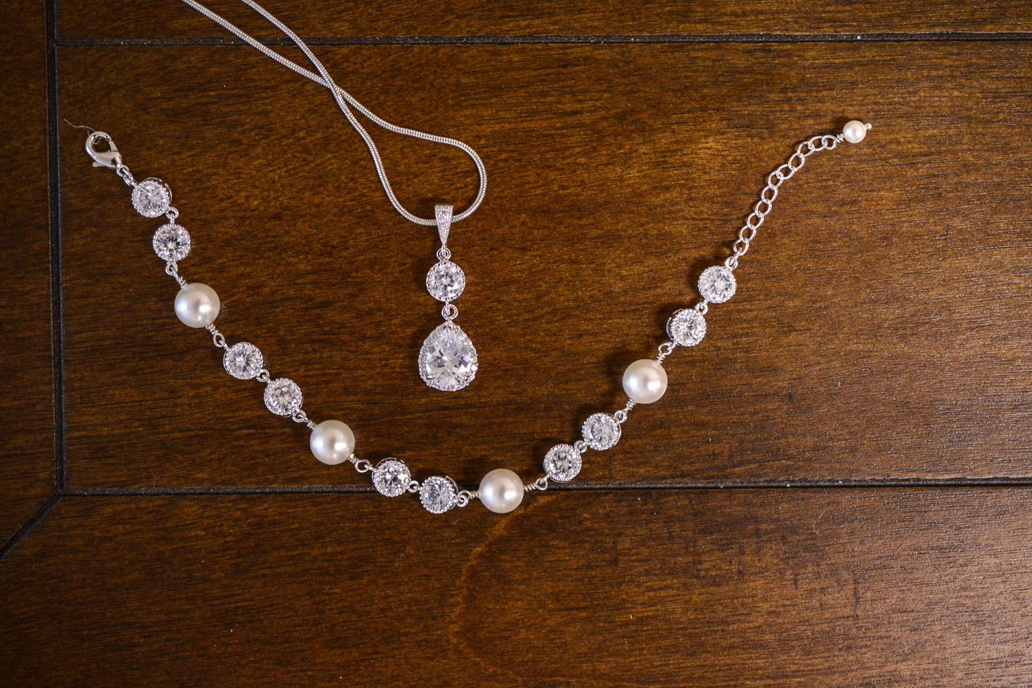 Bride's diamond jewelry on a wooden background |Maria Grace Photography