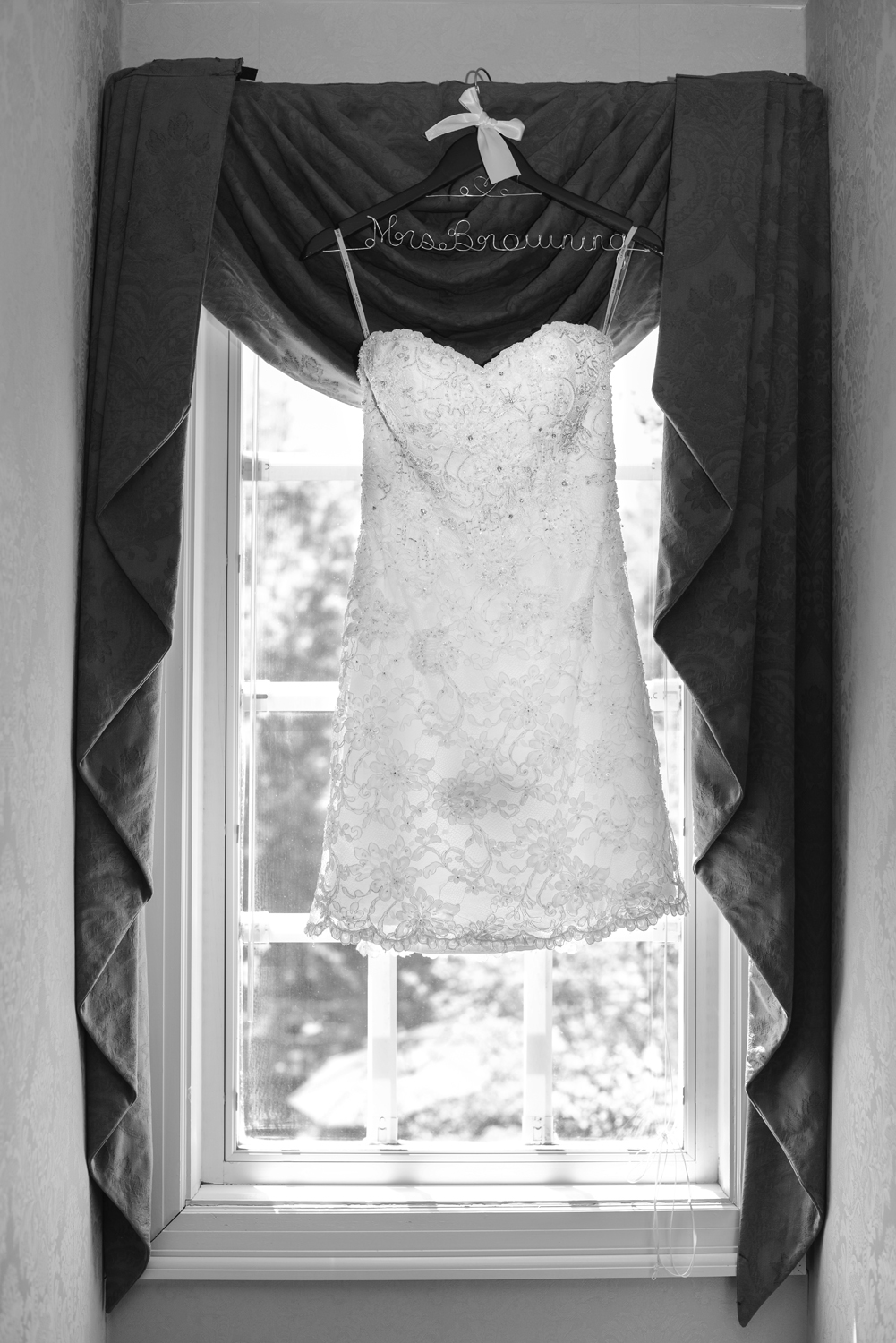 Short wedding dress in the window, black and white |Maria Grace Photography