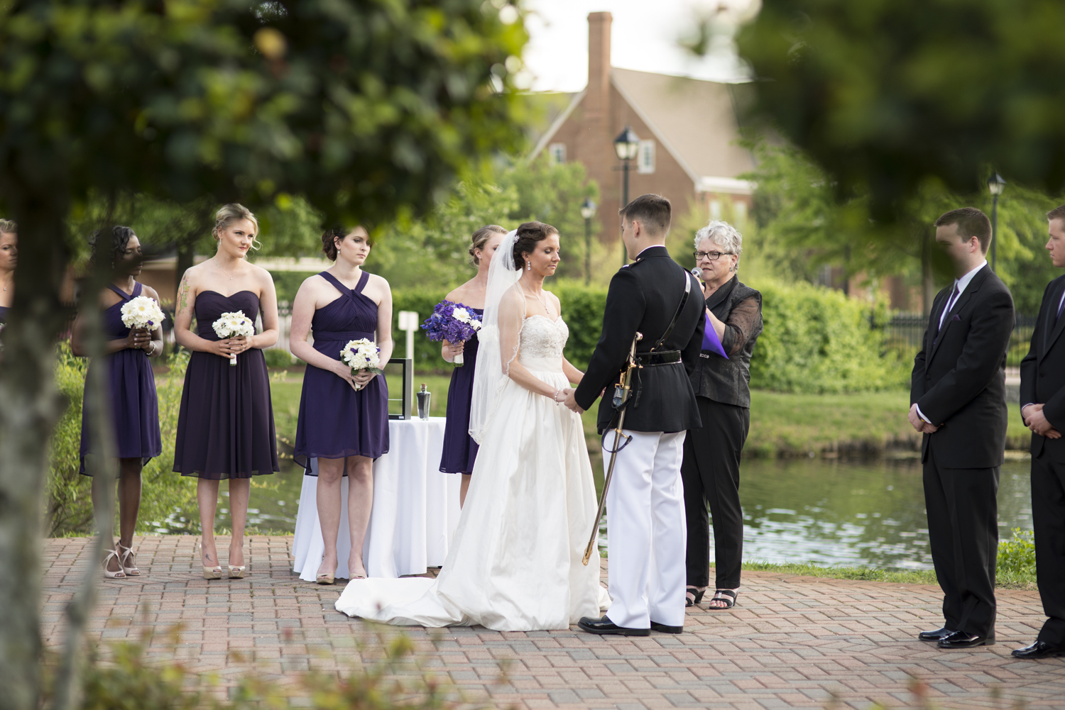 Bride and groom at altar overlooking the water |Maria Grace Photography
