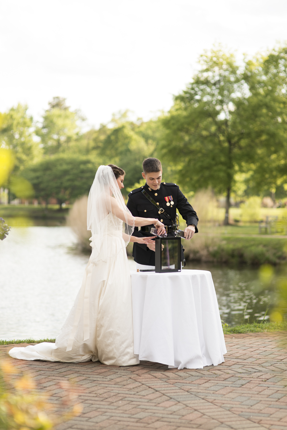 Bride and groom pouring unity sand at wedding | Maria Grace Photography