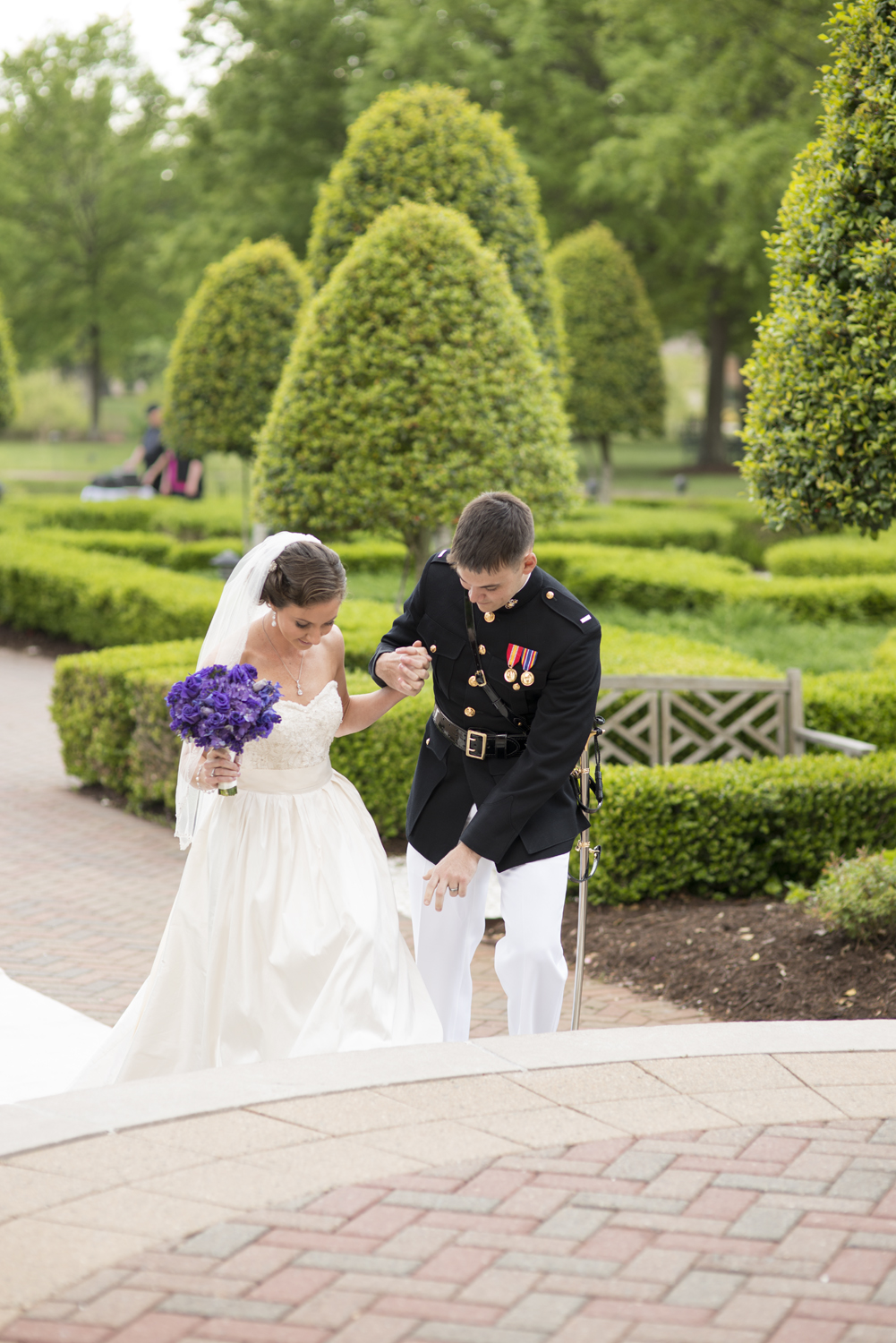Groom helping his bride down the aisle | Maria Grace Photography