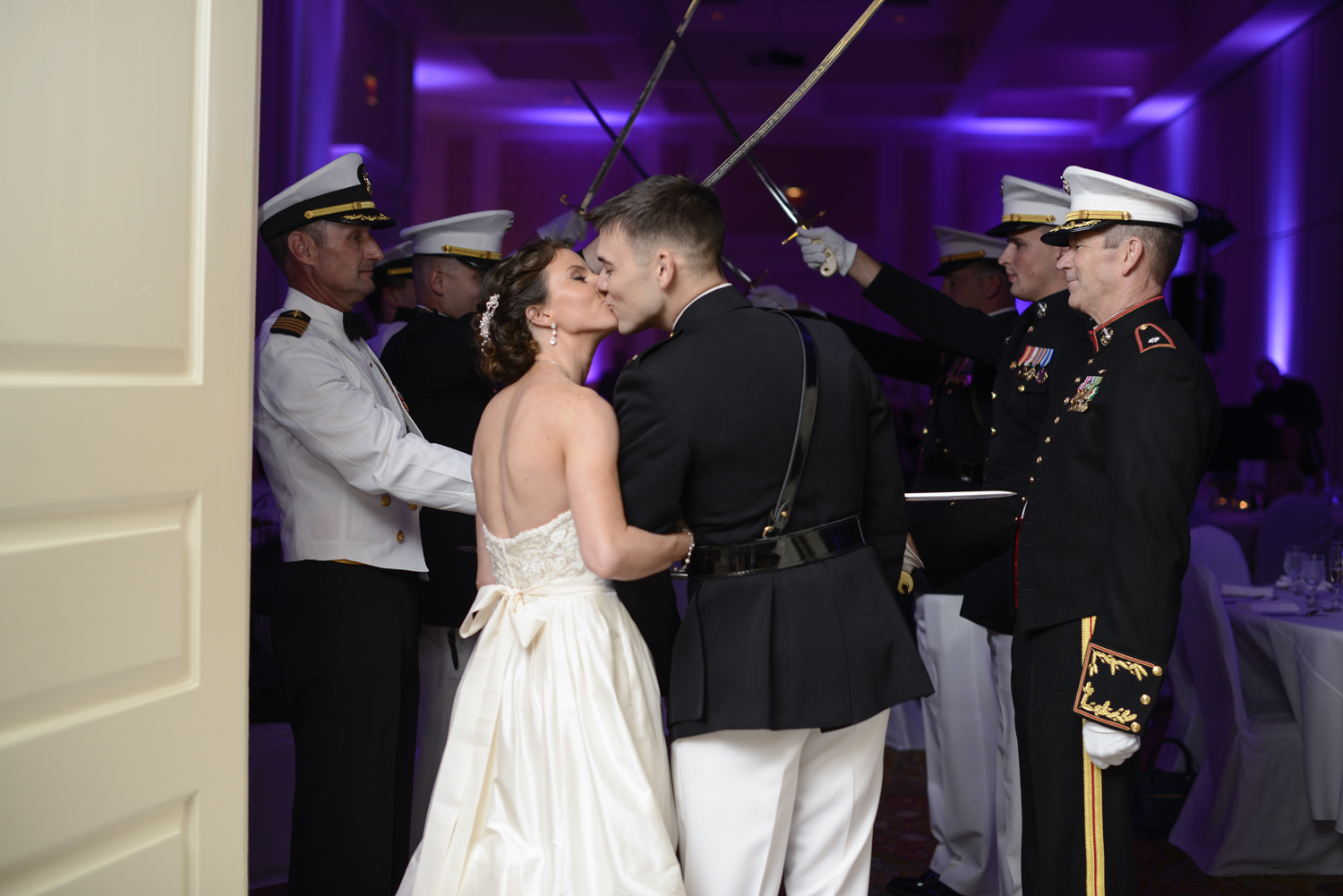 Bride and groom enter reception with a kiss through the navy arch | Maria Grace Photography