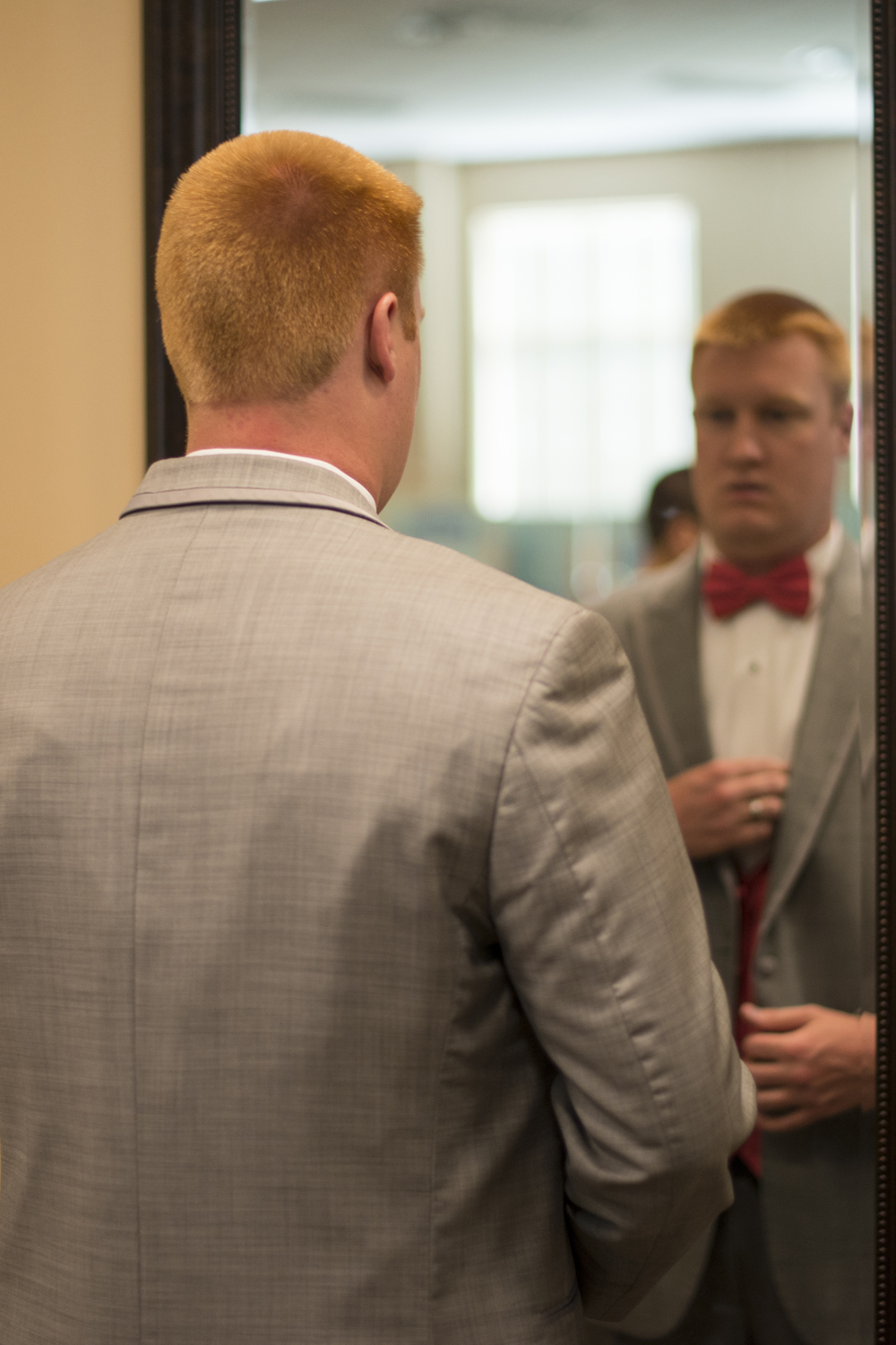 Groomsman getting ready for a wedding at Liberty Baptist Church