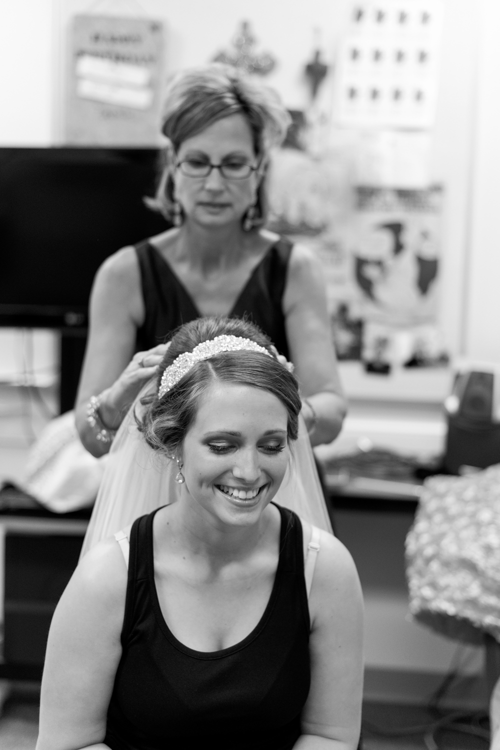 Black and white bride putting on veil at Liberty Baptist Church