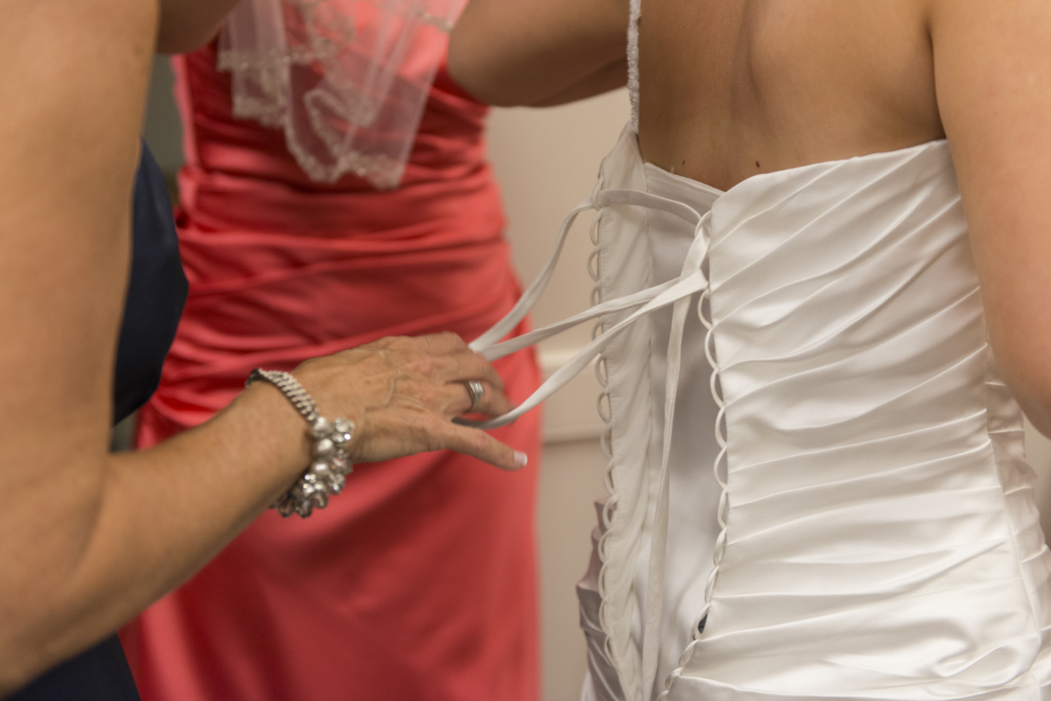 Detail shot of bride getting ready with her mother