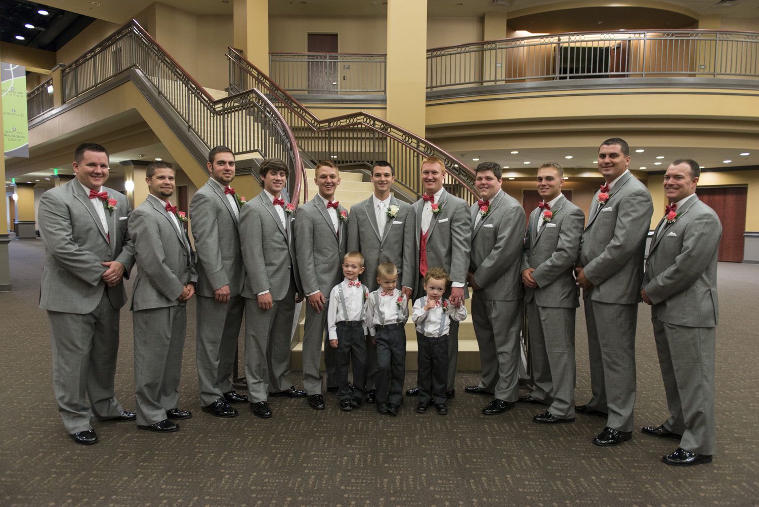 Groomsmen in gray suits and pink bow ties at Liberty Baptist Church