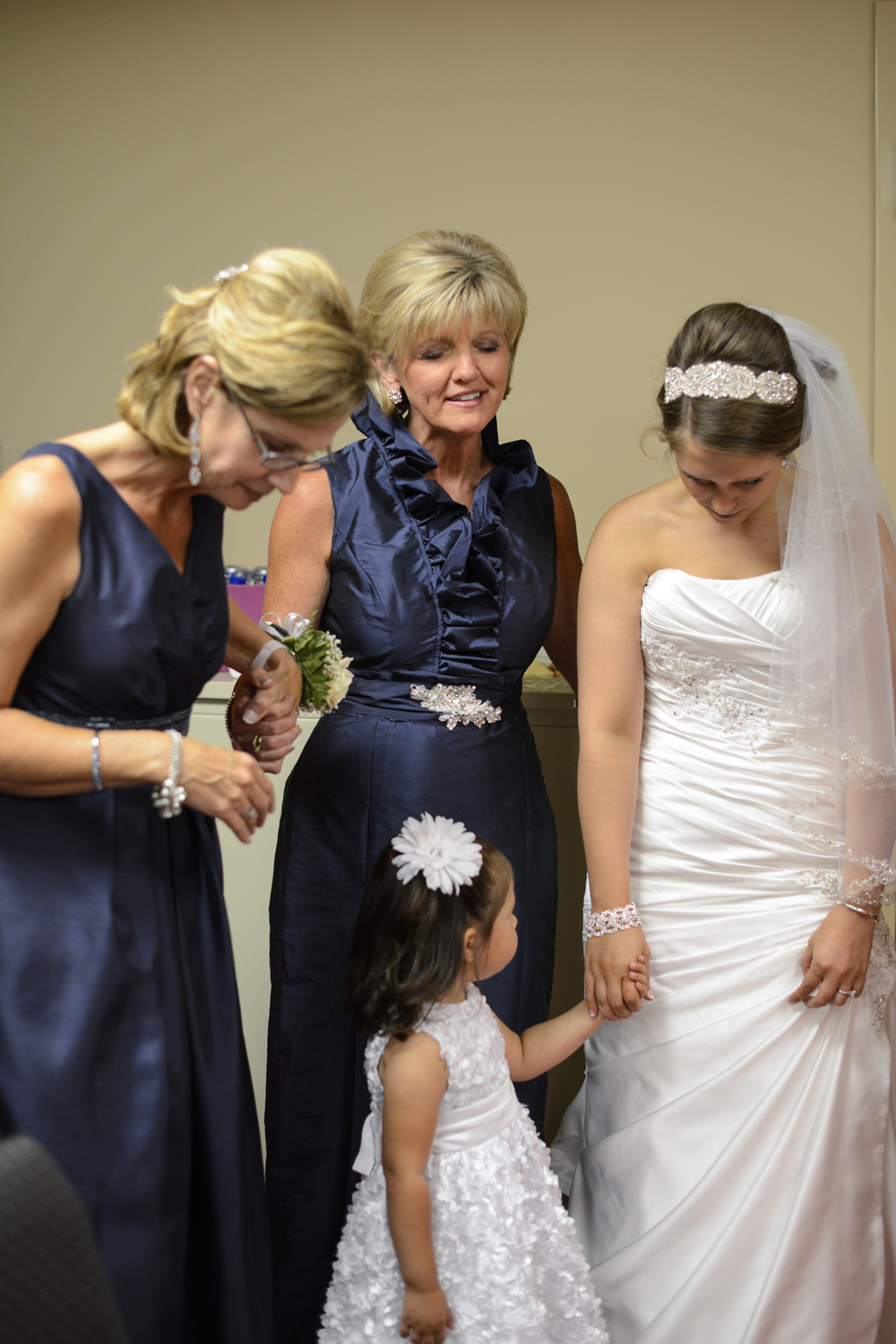 Bridal party praying moments before a wedding ceremony at Liberty Baptist Church
