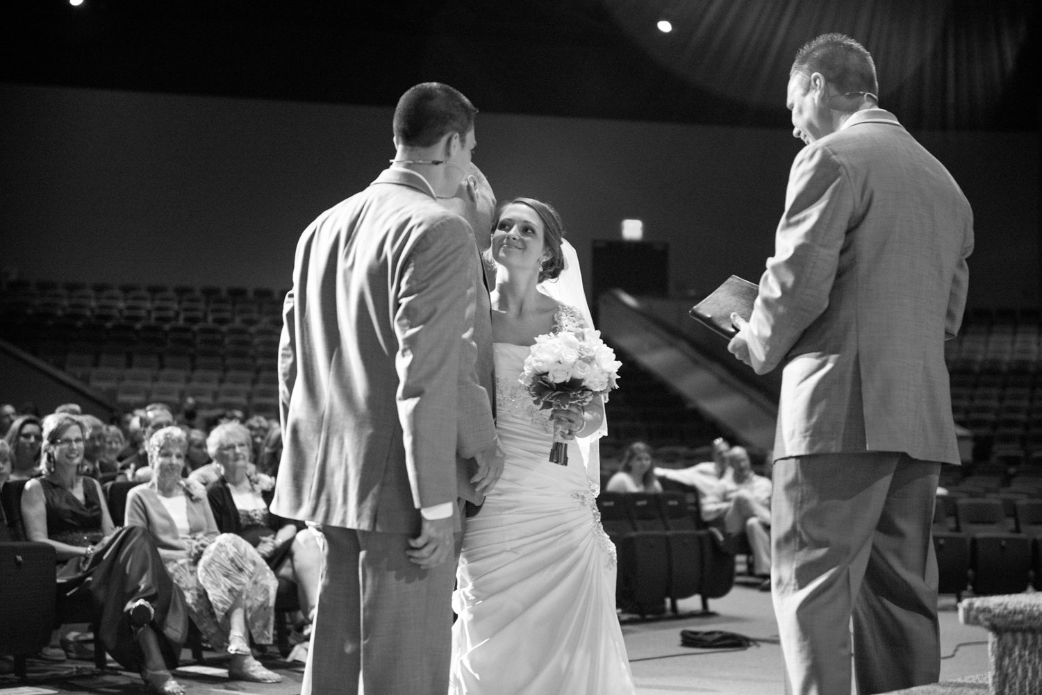 Father giving his daughter away at a wedding, black and white