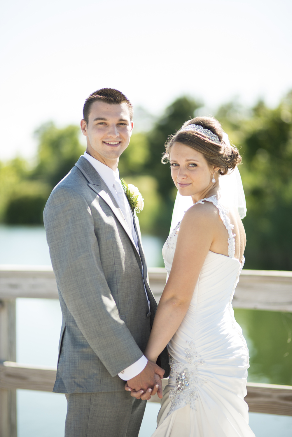 Bride and groom portrait on a pier by the water in Suffolk, Virginia