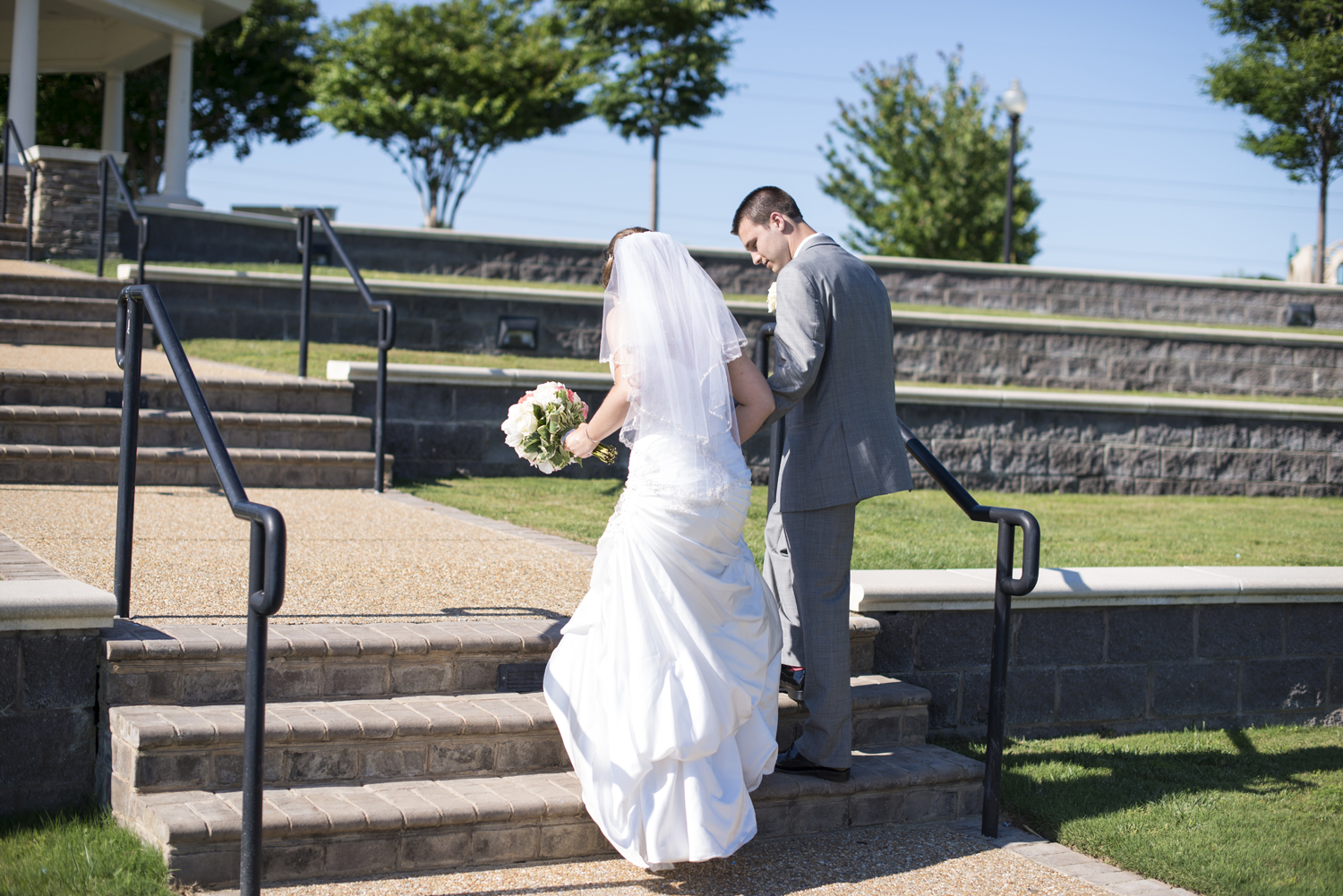 Bride and groom portrait on steps by the water in Suffolk, Virginia