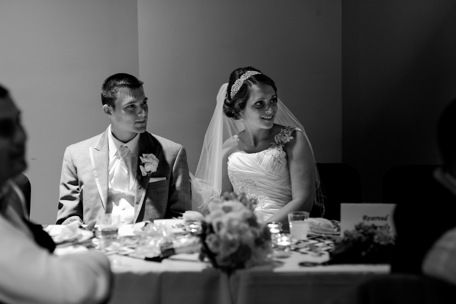 Bride and groom in black and white at wedding reception at Liberty Baptist Church in Suffolk, Virginia