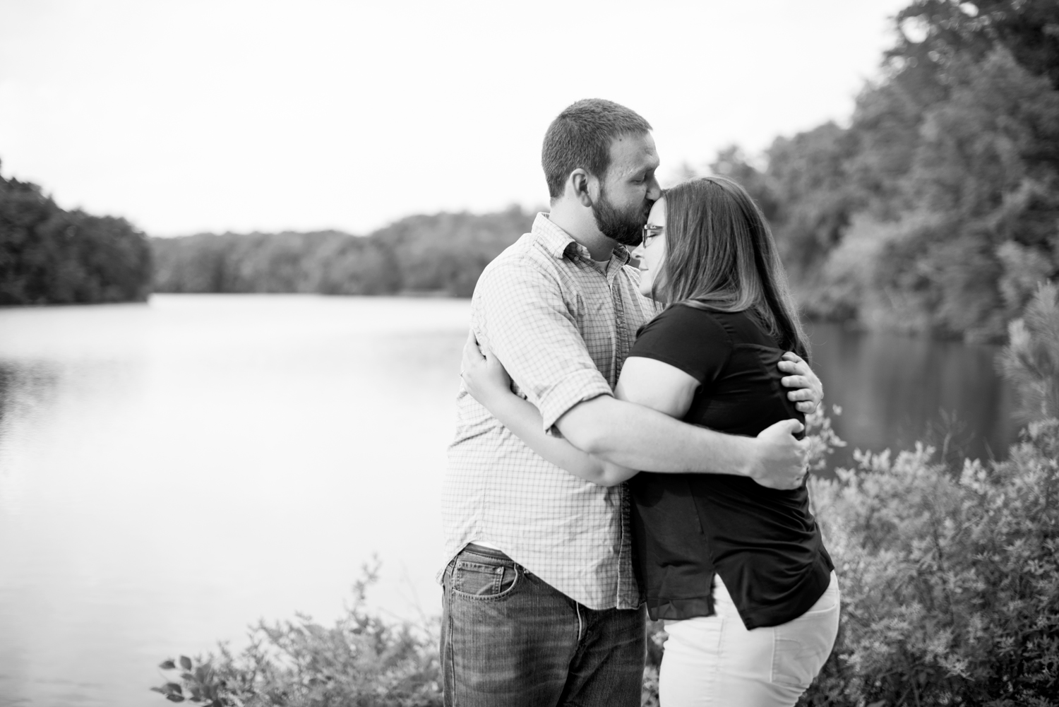 Joyful engagement pictures at Lions Bridge Park in Newport News, Virginia (black and white)