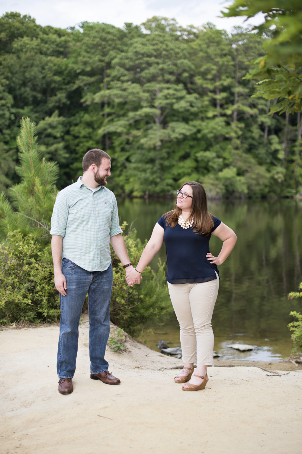 Khaki and navy blue engagement pictures at Lions Bridge Park in Newport News, Virginia