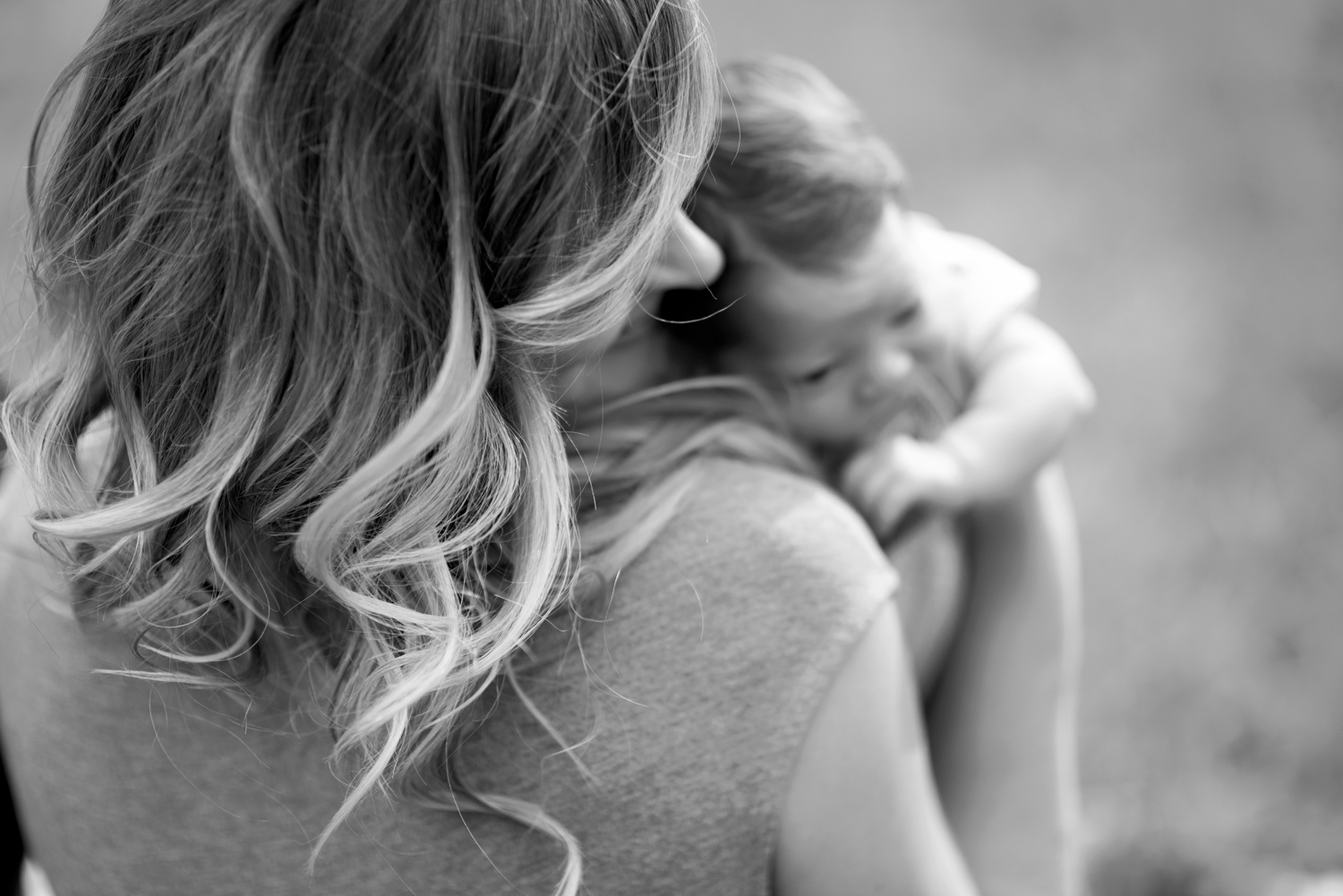 Black and white picture of the beauty of motherhood with her newborn baby boy