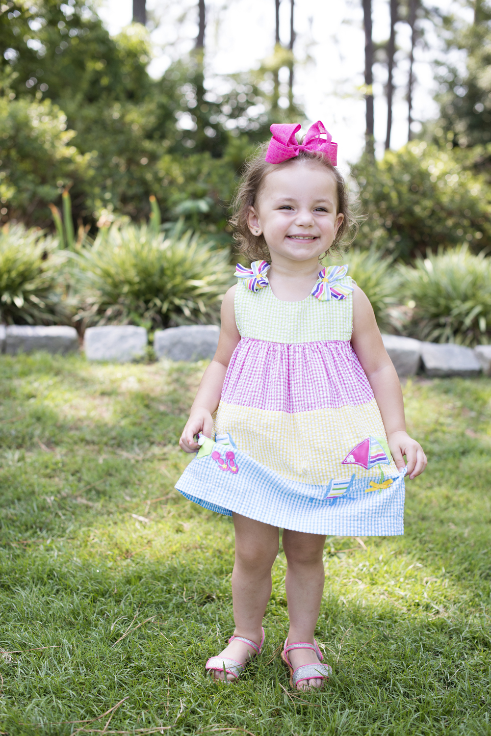 Adorable little girl in a sundress at family portraits in Portsmouth, Virginia