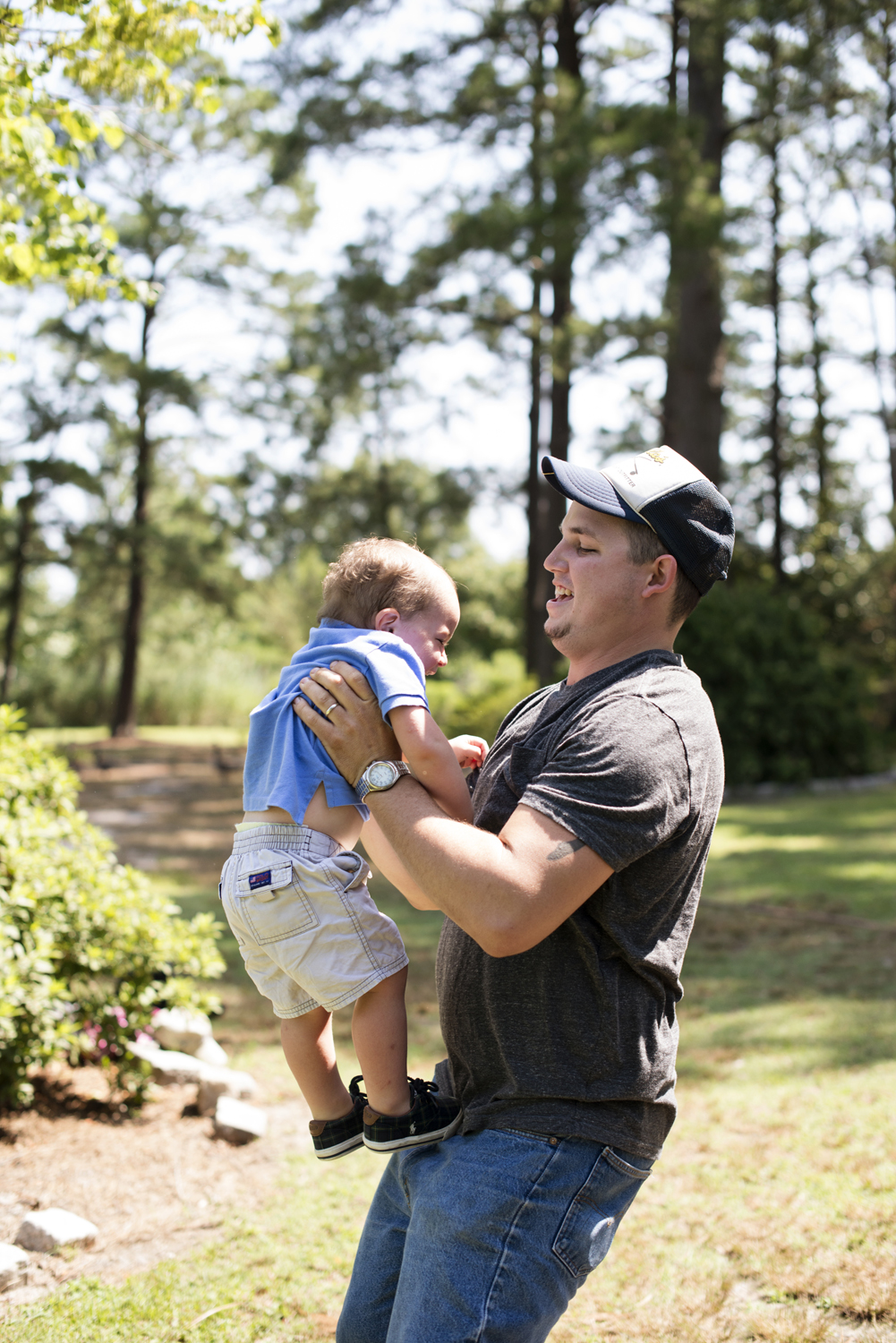 Dad playing with his son at family portraits in Portsmouth, Virginia