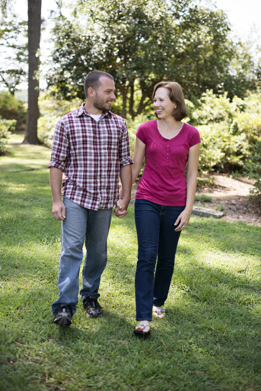 Husband and wife walk hand-in-hand at family portraits in Portsmouth, Virginia