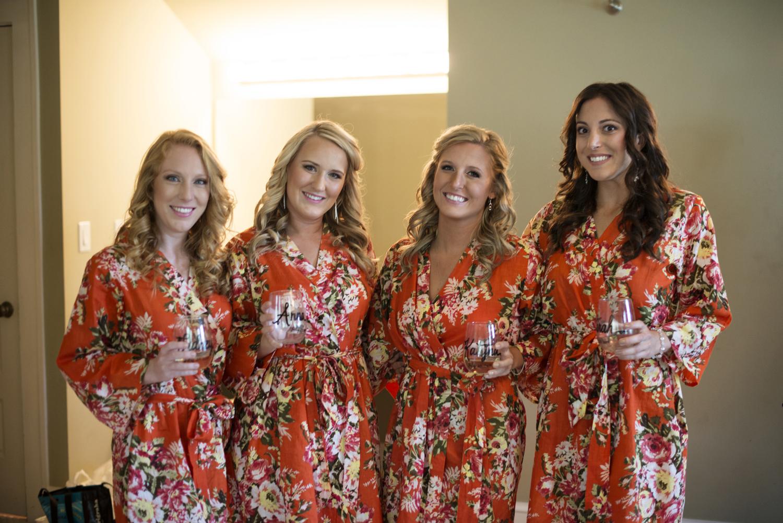 Bridesmaids in bright orange flower robes | Portsmouth Woman's Club in Virginia