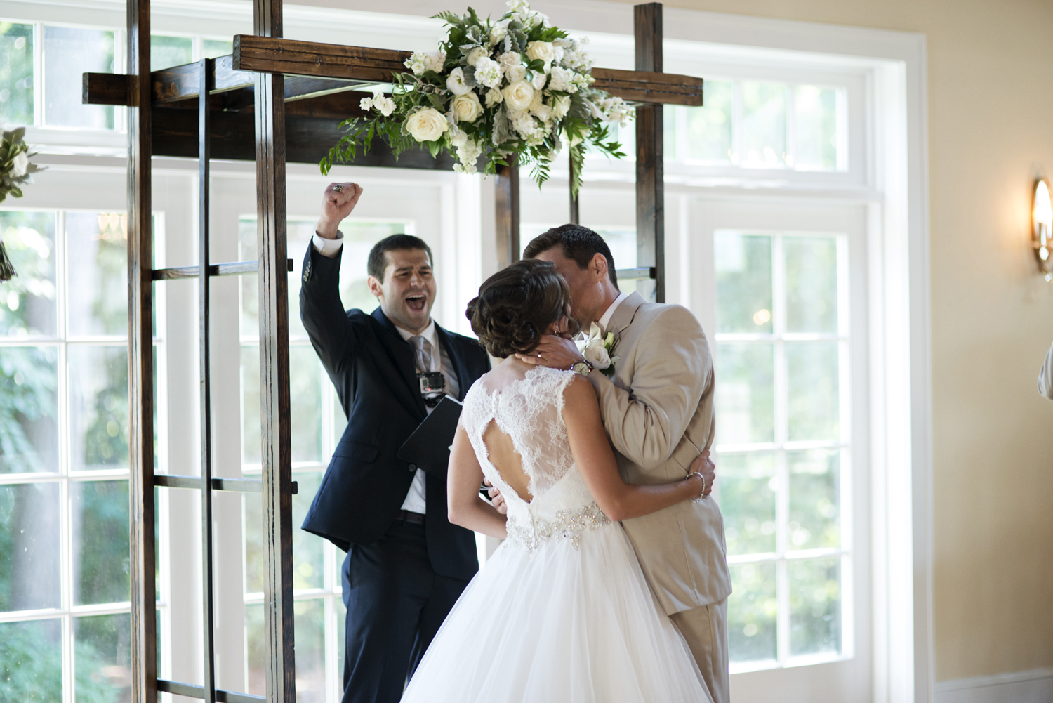 Bride and groom kiss at the altar | Portsmouth Woman's Club in Virginia