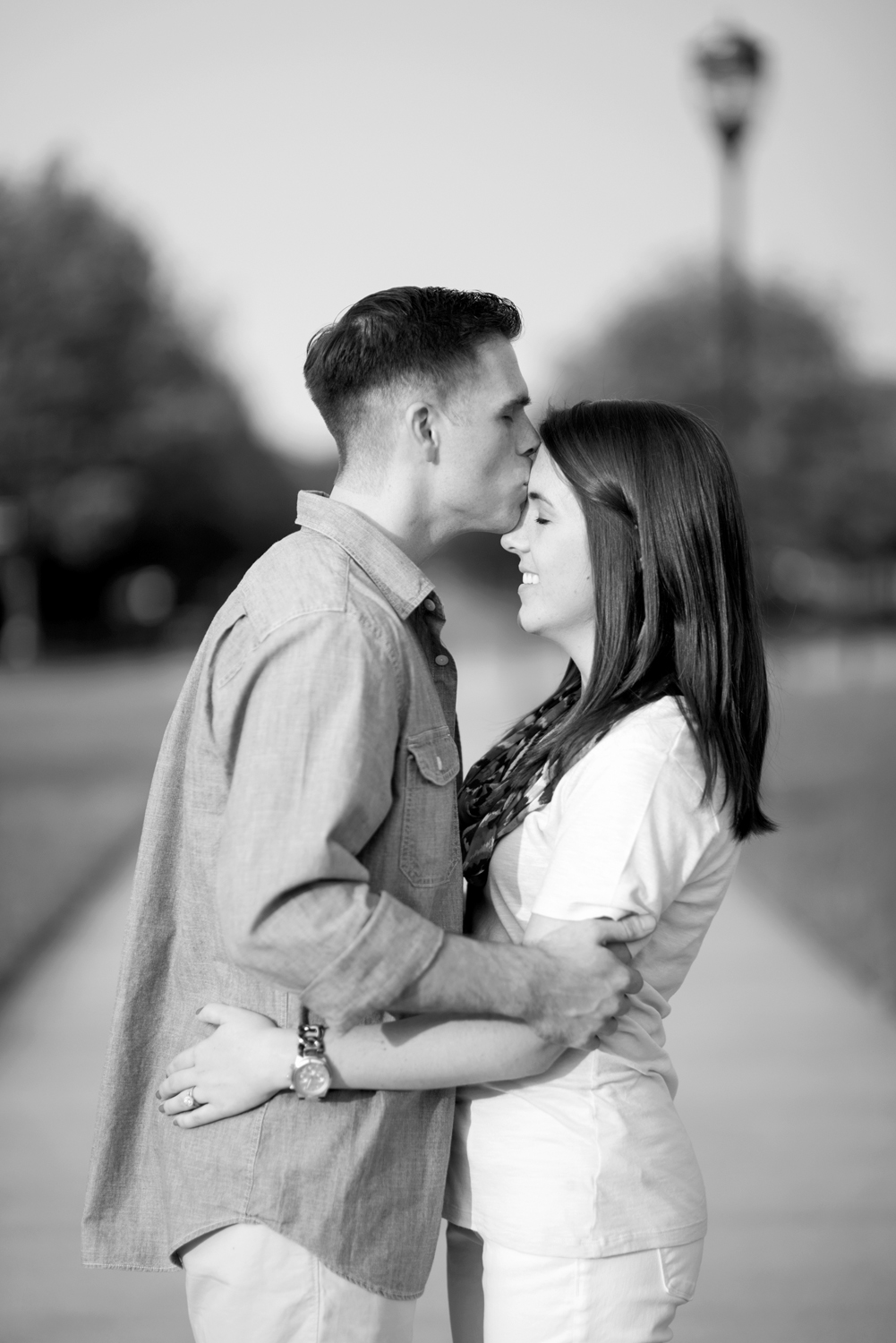 Couple kisses during annivesary pictures in Port Warwick, Newport News, Virginia (black and white)