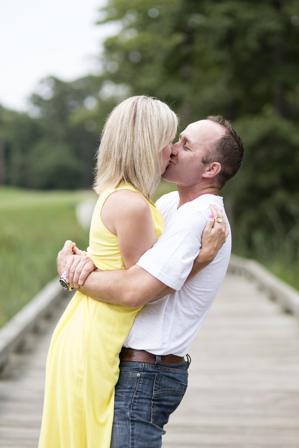 Anniversary portraits in a bright yellow dress at Princess Anne Country Club Golf Course in Virginia Beach