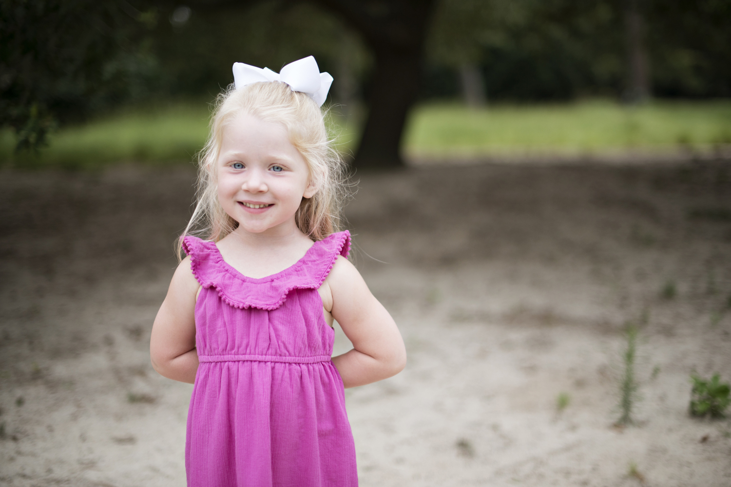 Little girl in a pink dress at family portraits  at Princess Anne Country Club Golf Course in Virginia Beach