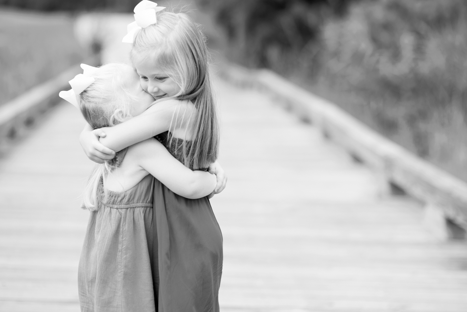 Sisters hugging each other (black and white)