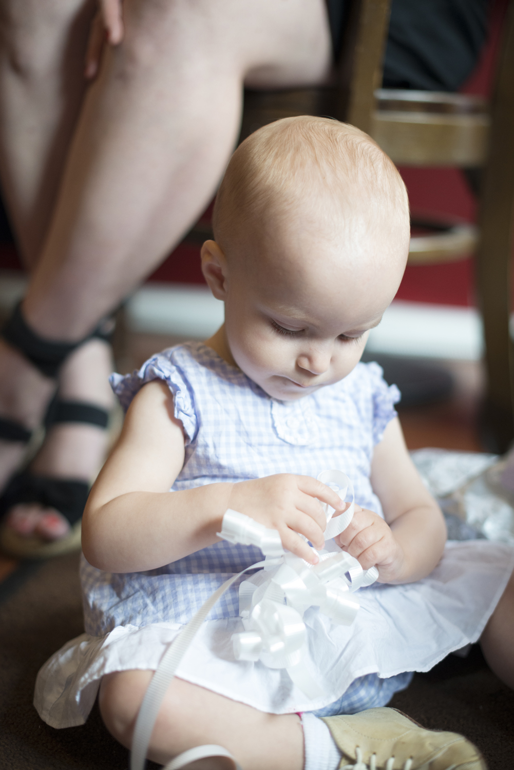 Baby in a gingham blue and white dress