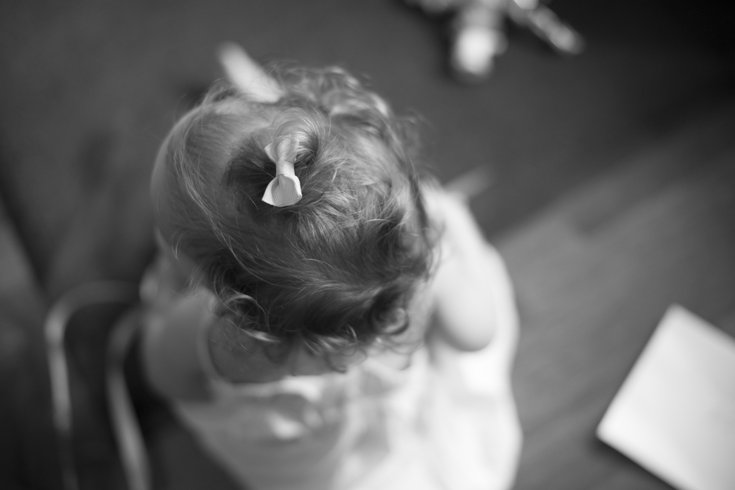 Baby with bow on her head (black and white)