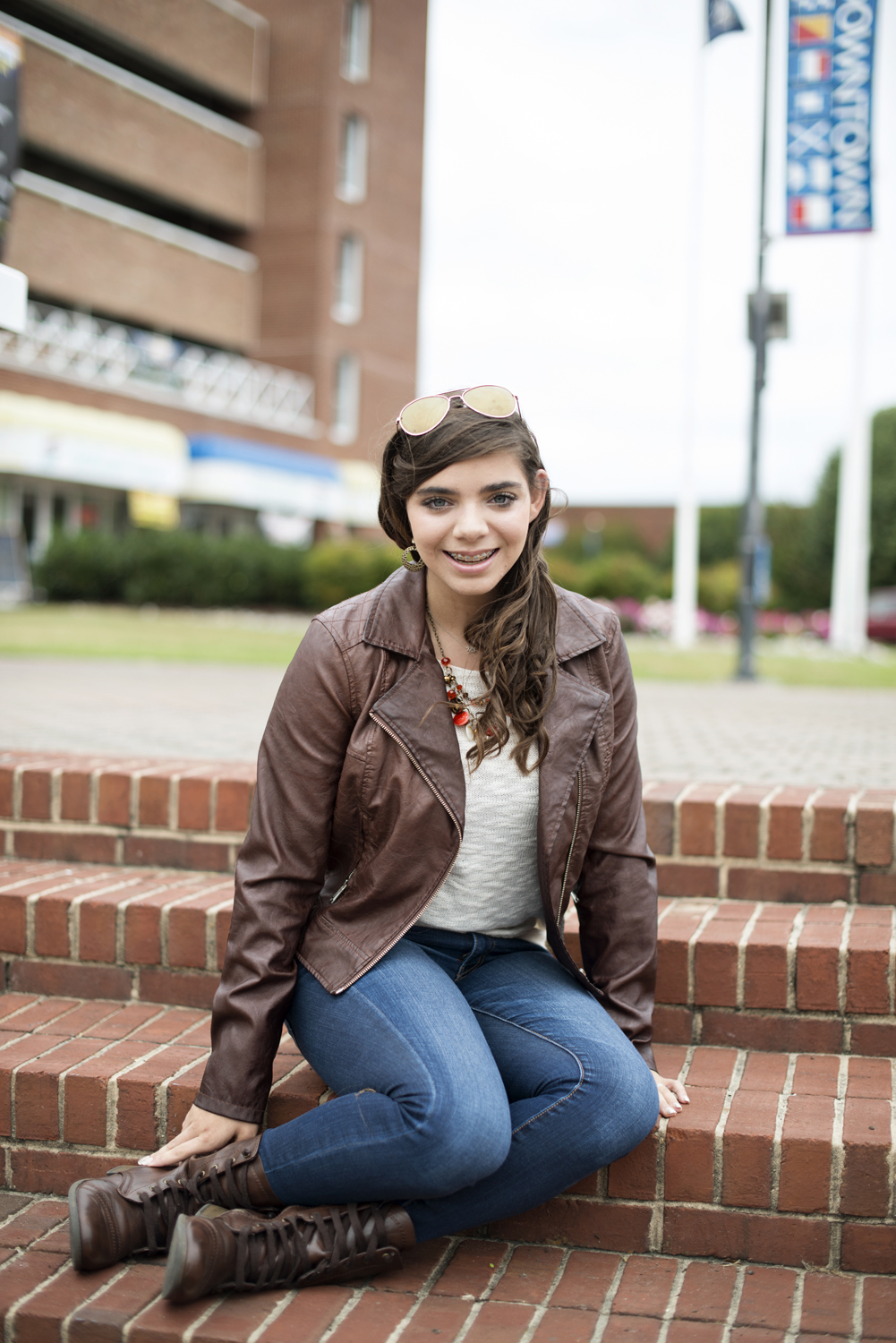 Downtown Virginia senior portraits | leather jacket and sunglasses