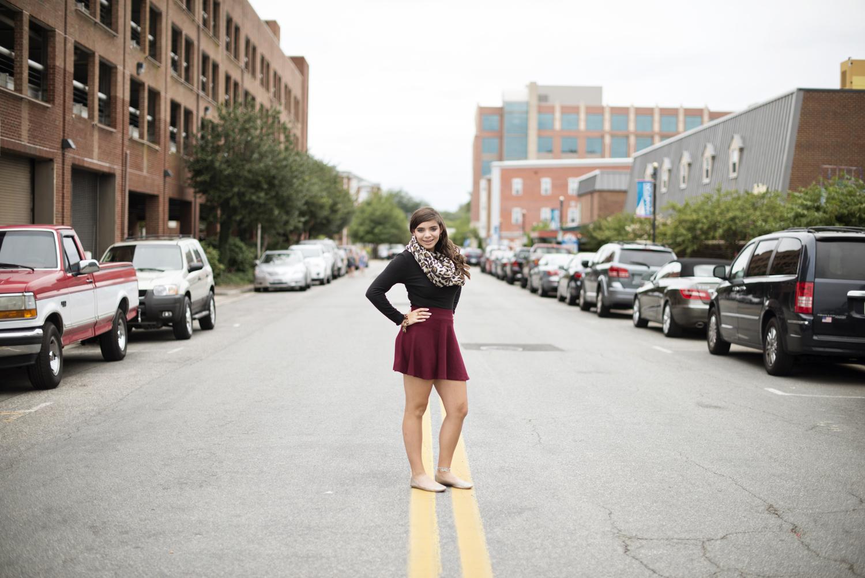 Downtown urban senior portraits | cranberry red skirt and leapord print scarf | Hampton, Virginia