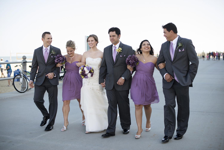 Bridal party walking on boardwalk   Fall hotel wedding in Virginia Beach