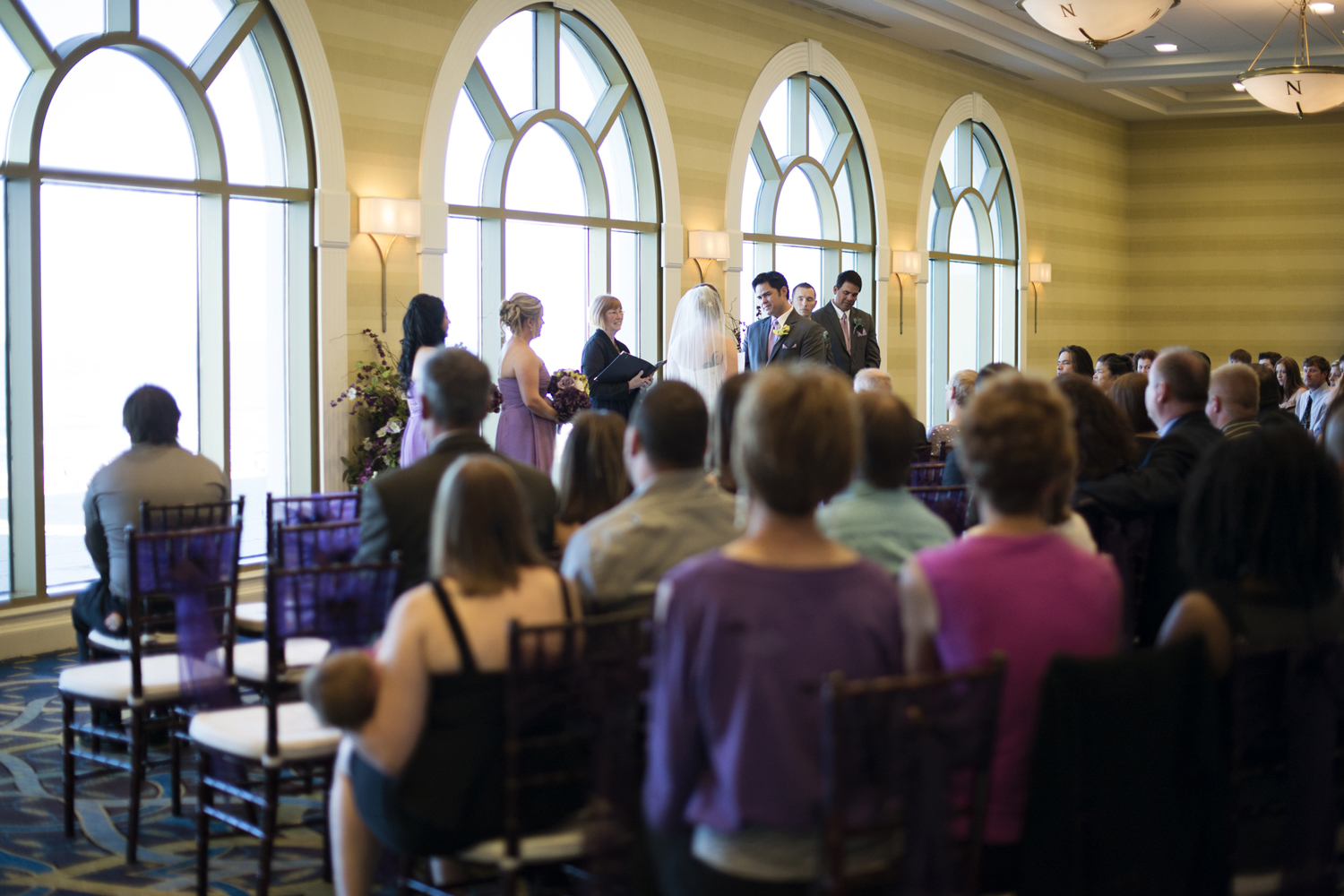 Bride and groom at wedding ceremony  | Fall hotel wedding in Virginia Beach