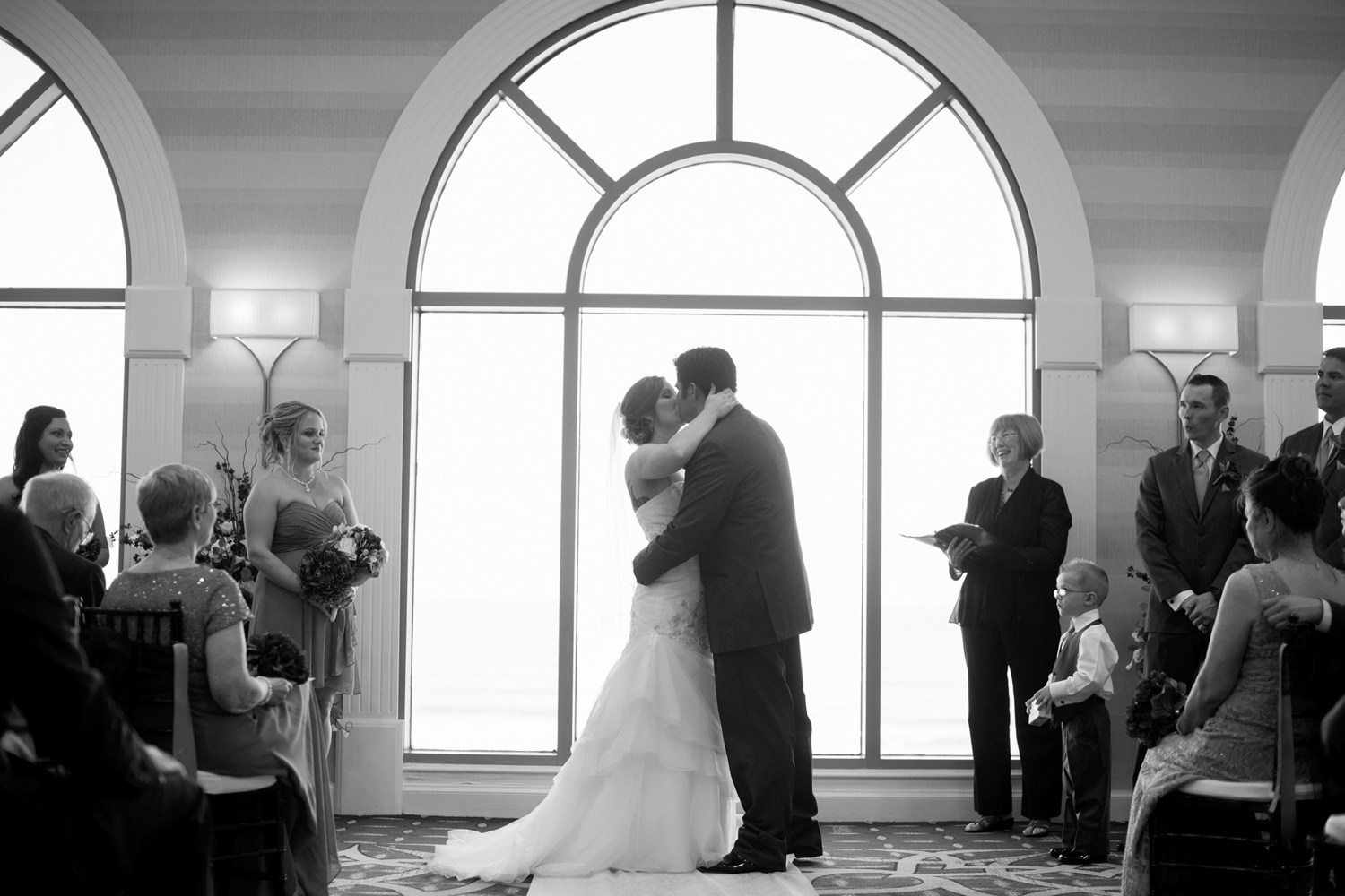 Bride and groom's first kiss at wedding ceremony  | Fall hotel wedding in Virginia Beach