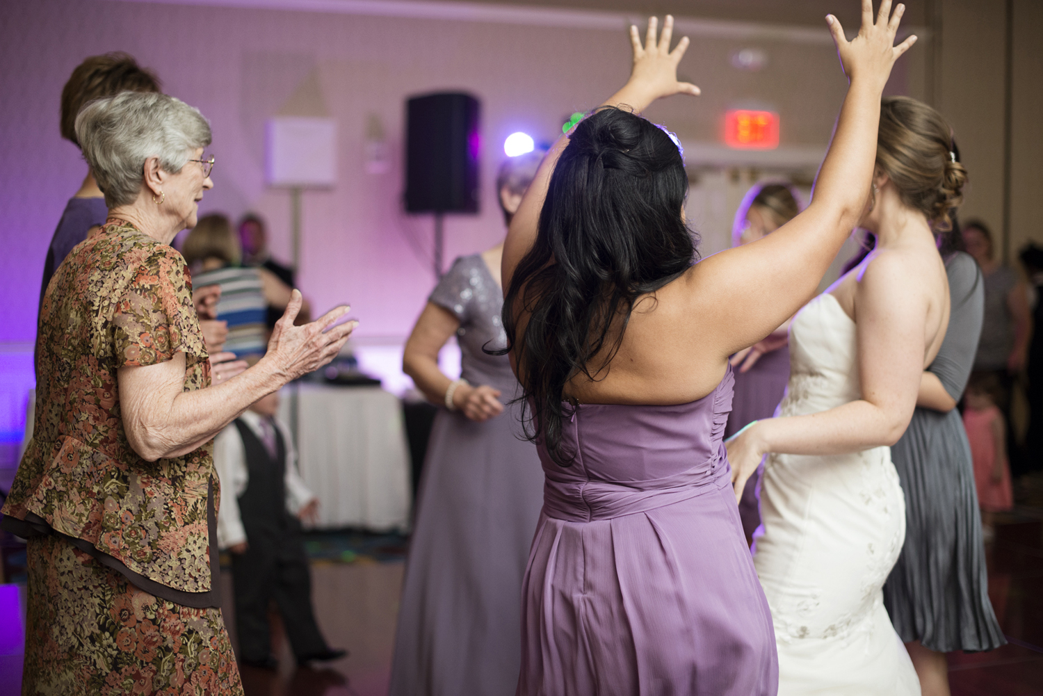 Guests dancing at the reception  | Fall hotel wedding in Virginia Beach