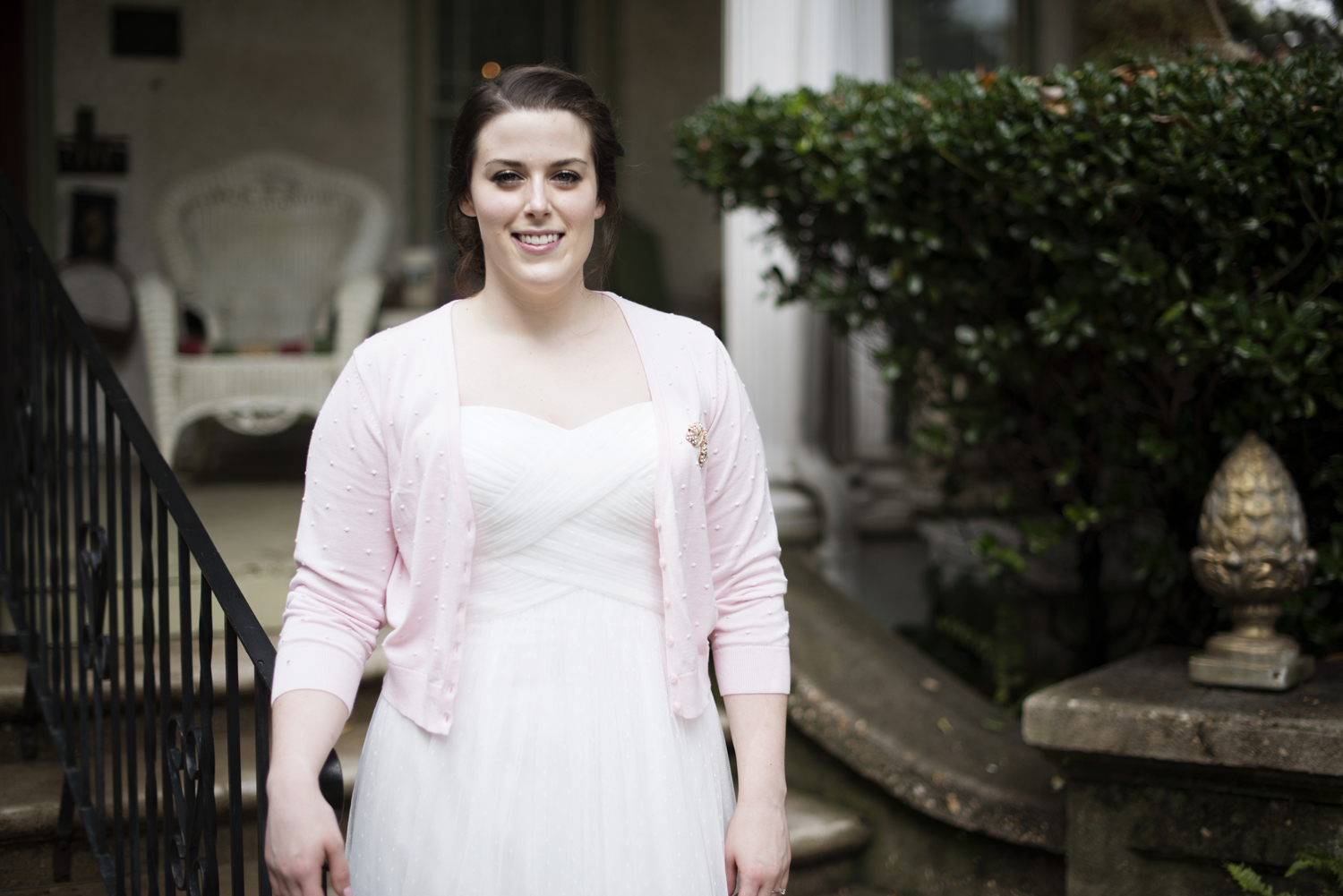 A bride by the steps of the Magnolia House Inn in Hampton, Virginia