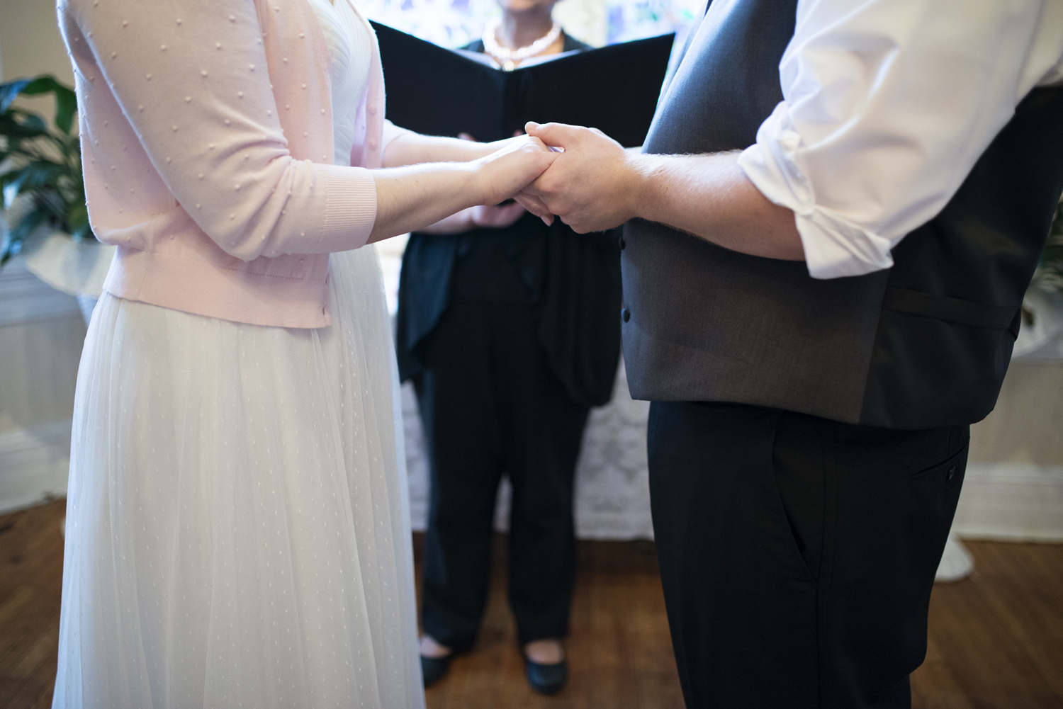 Bride and groom hold hands during their wedding | Magnolia House Inn