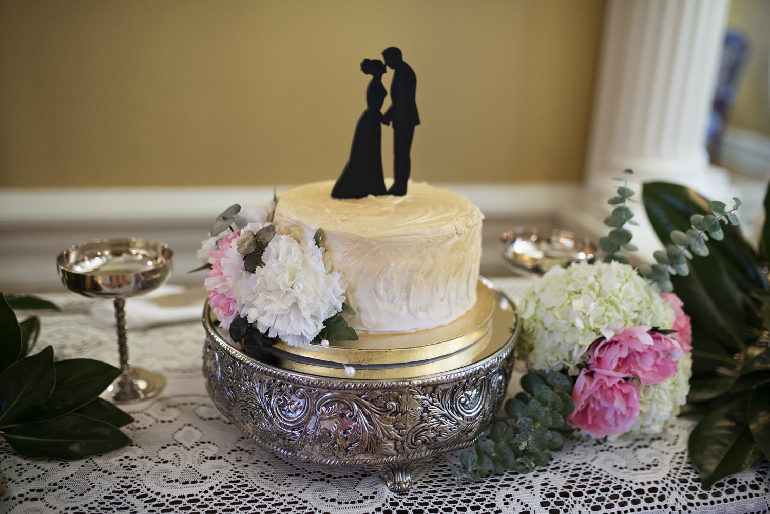 A wedding cake for two with a silhouette topper