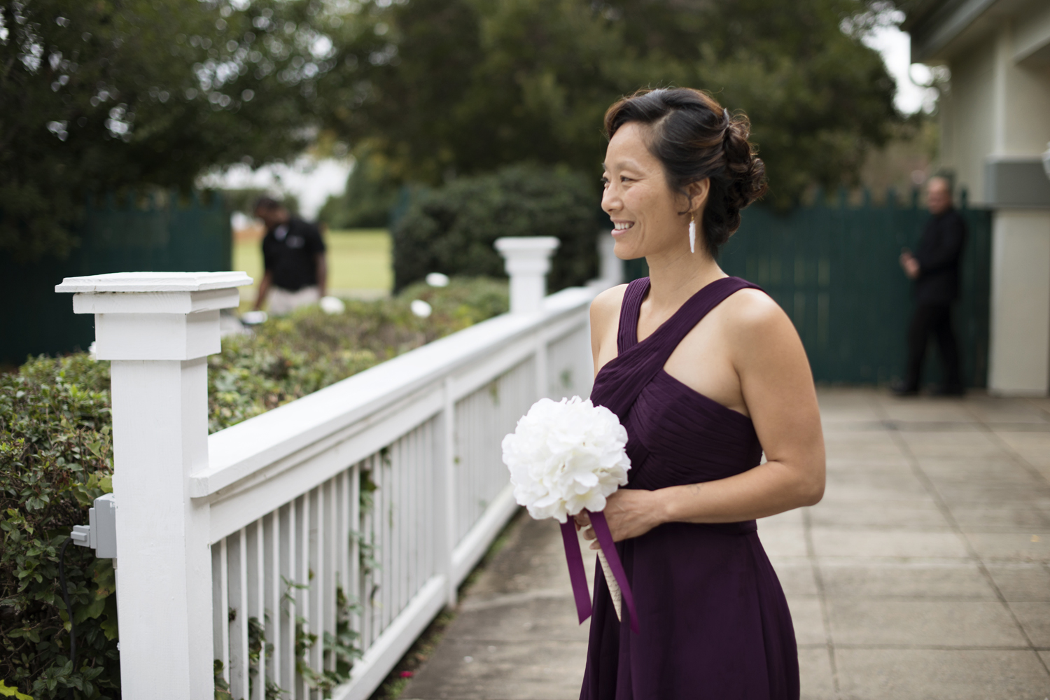 Maid of honor wearing purple at an outdoor wedding in Virginia