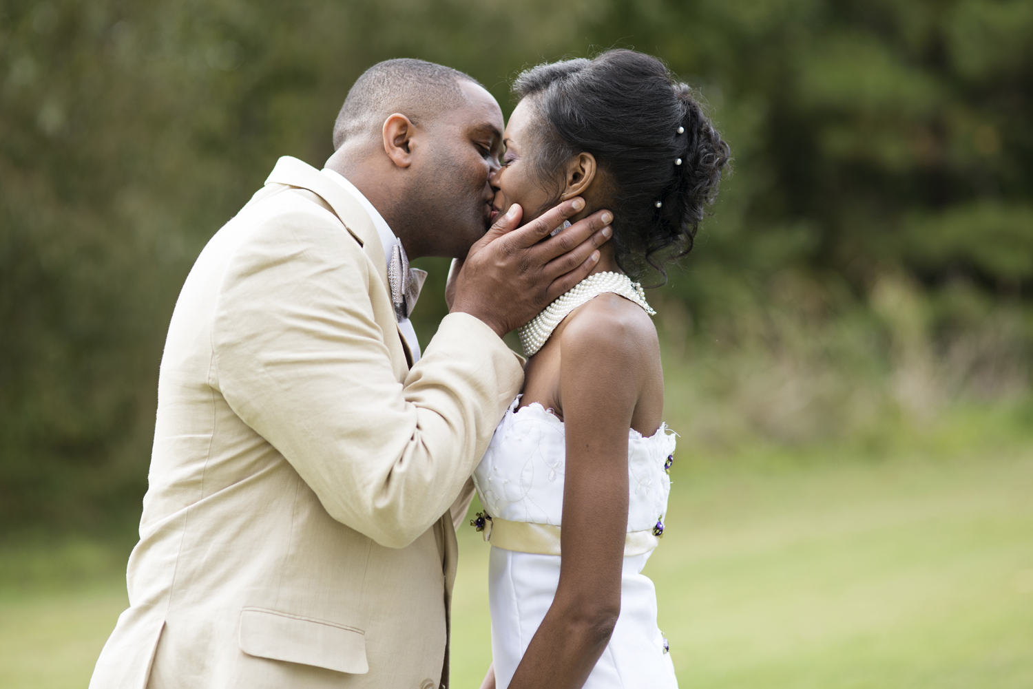 Groom pulls bride in for a kiss after their October wedding in Virginia