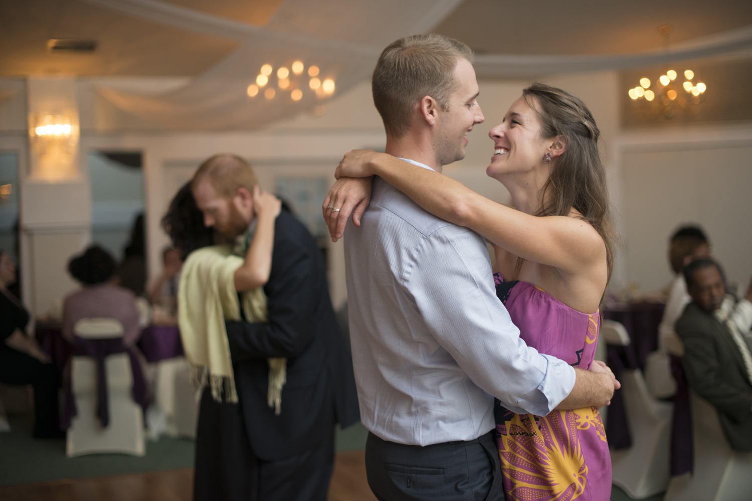 Wedding guests dance at the reception