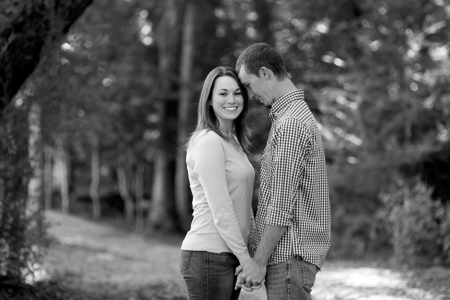 Newlyweds take anniversary portraits at a park in the fall (black and white)