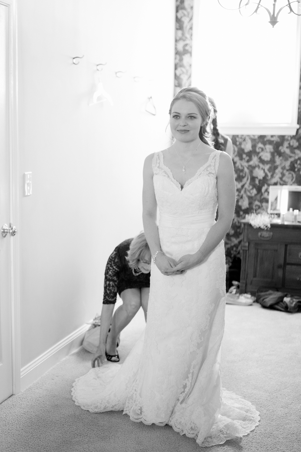 Bride sees herself in the mirror for the first time on her wedding day.