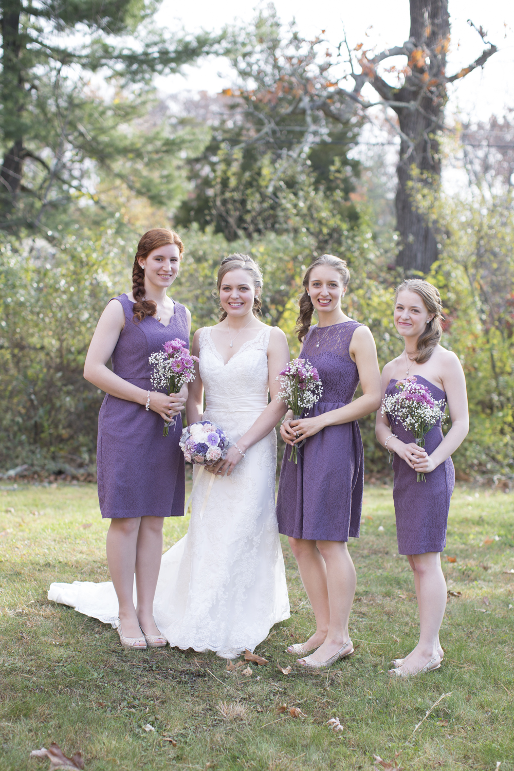 Bridesmaids in lavender rustic dresses with lavender flowers and baby's breath