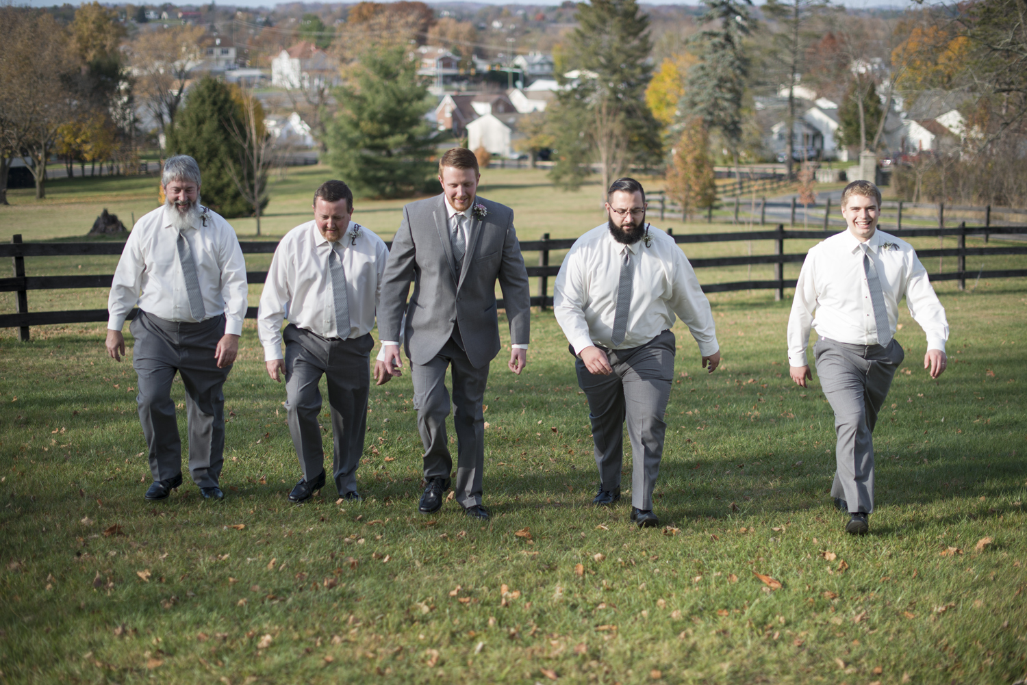 Epic picture of groomsmen in gray suits walking