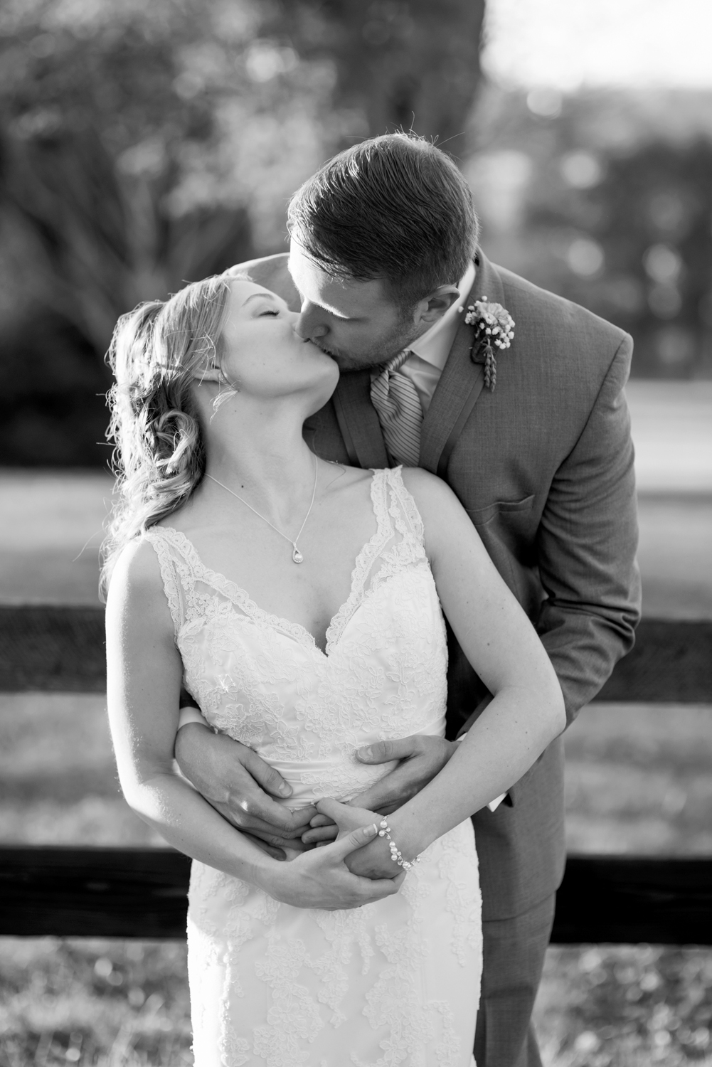 Classic, intimate bride and groom kiss (black and white)