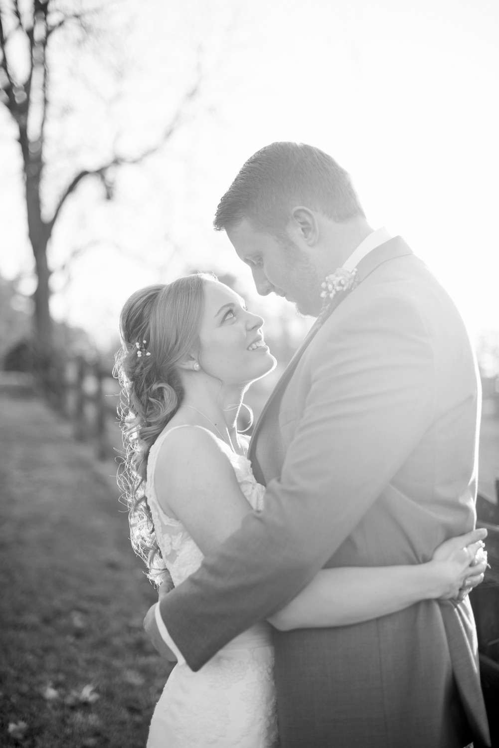 Bride and groom with lens flare (black and white)